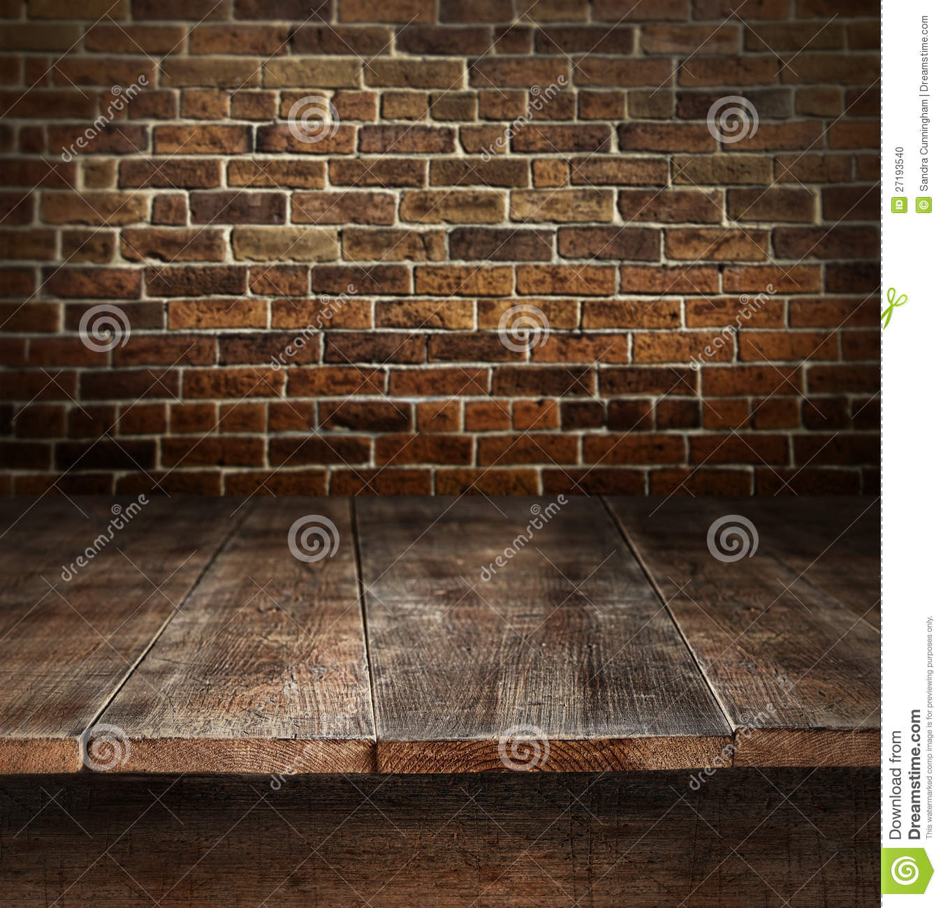Wooden table with brick background