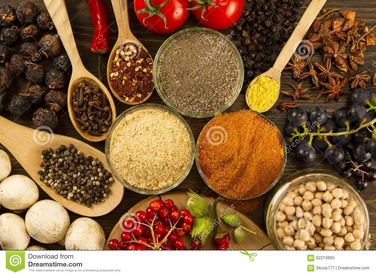 Wooden table with colorful spices herbs and vegetables for 7 spices asian cuisine