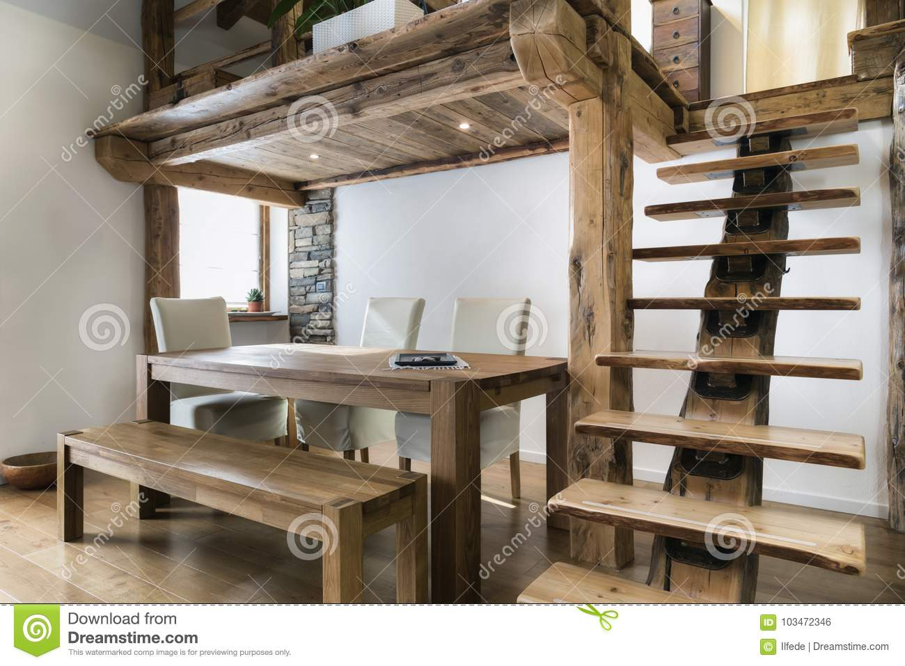Wooden Table In Dining Room Under Mezzanine