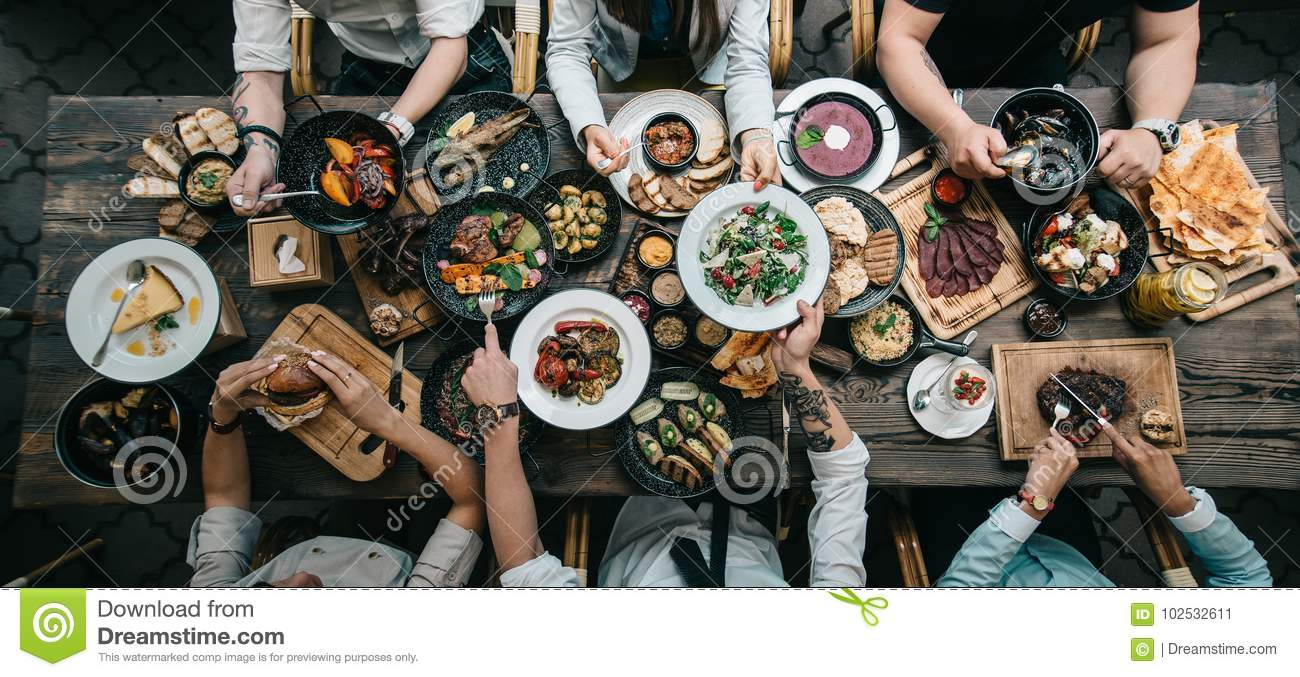 Wooden table with food, top view