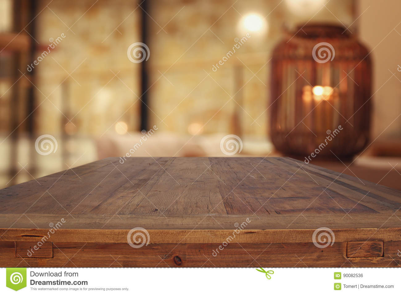 Wooden Table In Front Of Abstract Living Room Background Stock Photo