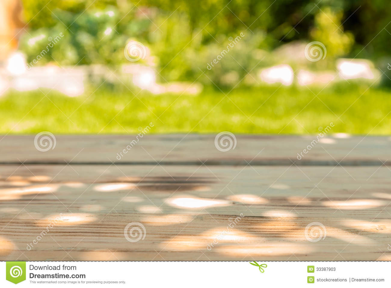 Wooden Table In A Garden In A Sunny Day Stock Image