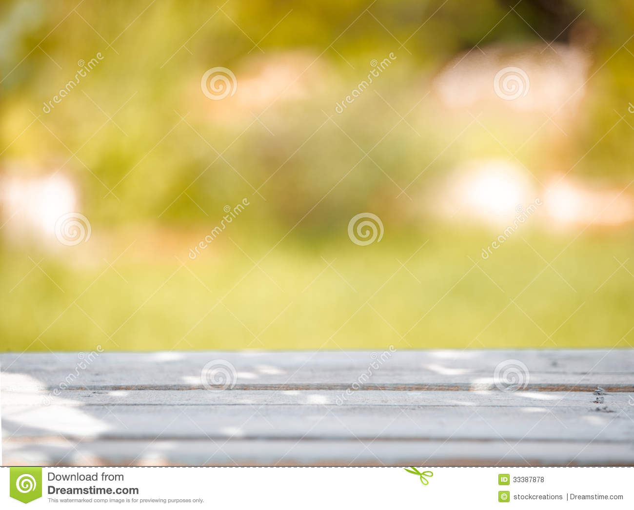 Wooden Table On A Green Blurred Background Royalty Free Stock Photos ...