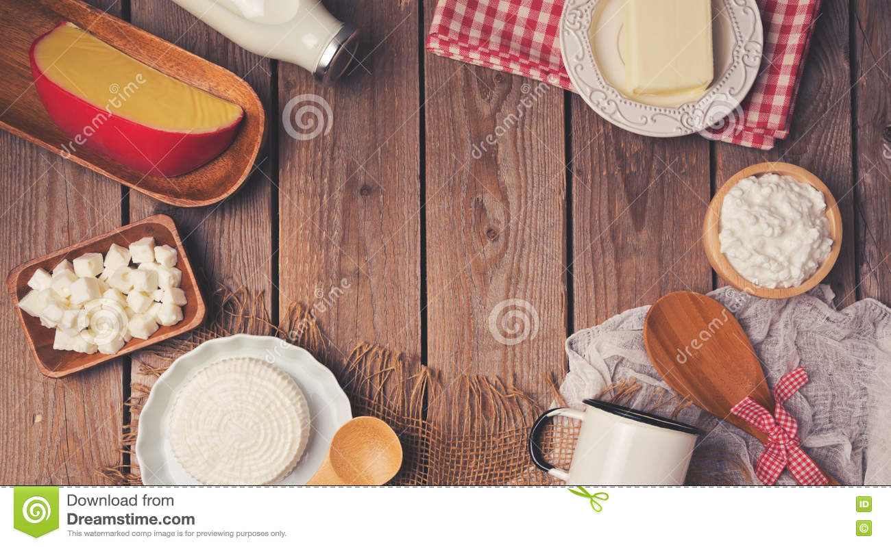 Wooden table with milk and cheese products. Healthy eating concept. Place for text. View from above.