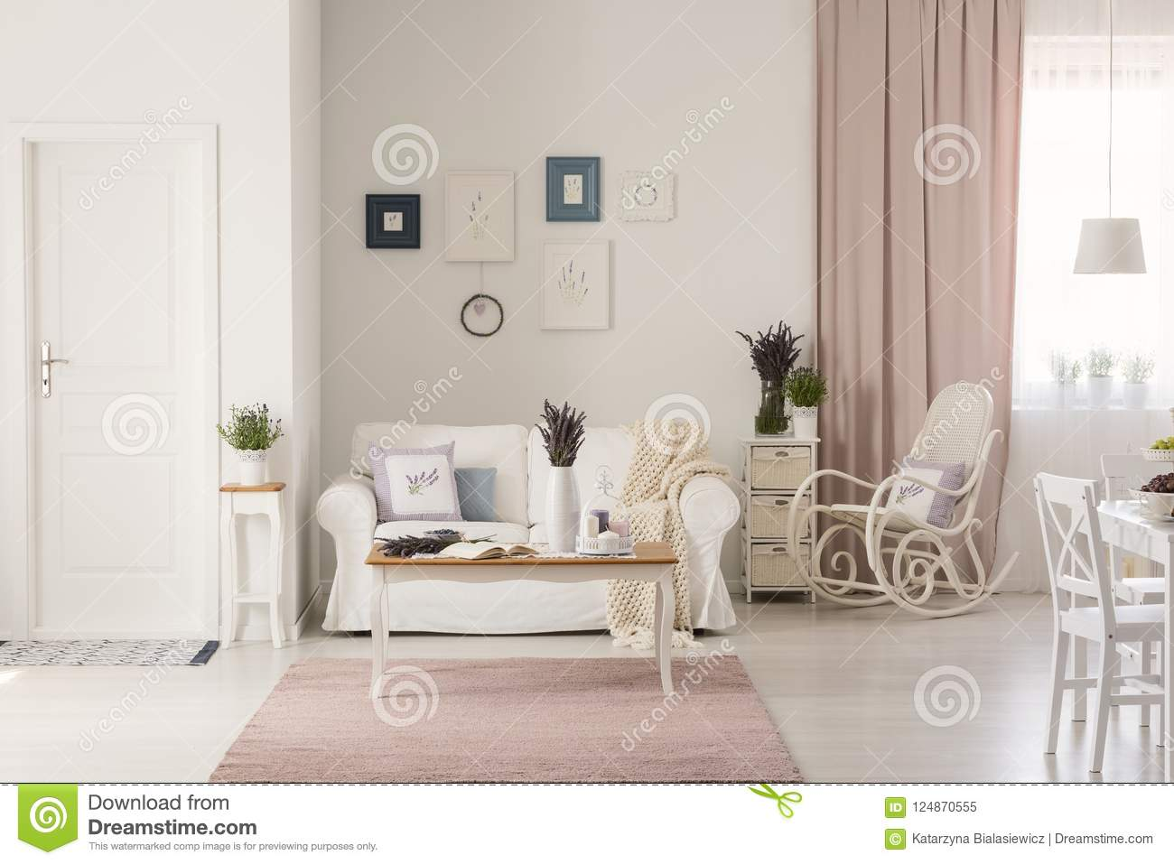 Wooden Table On Pink Rug In White Living Room Interior With