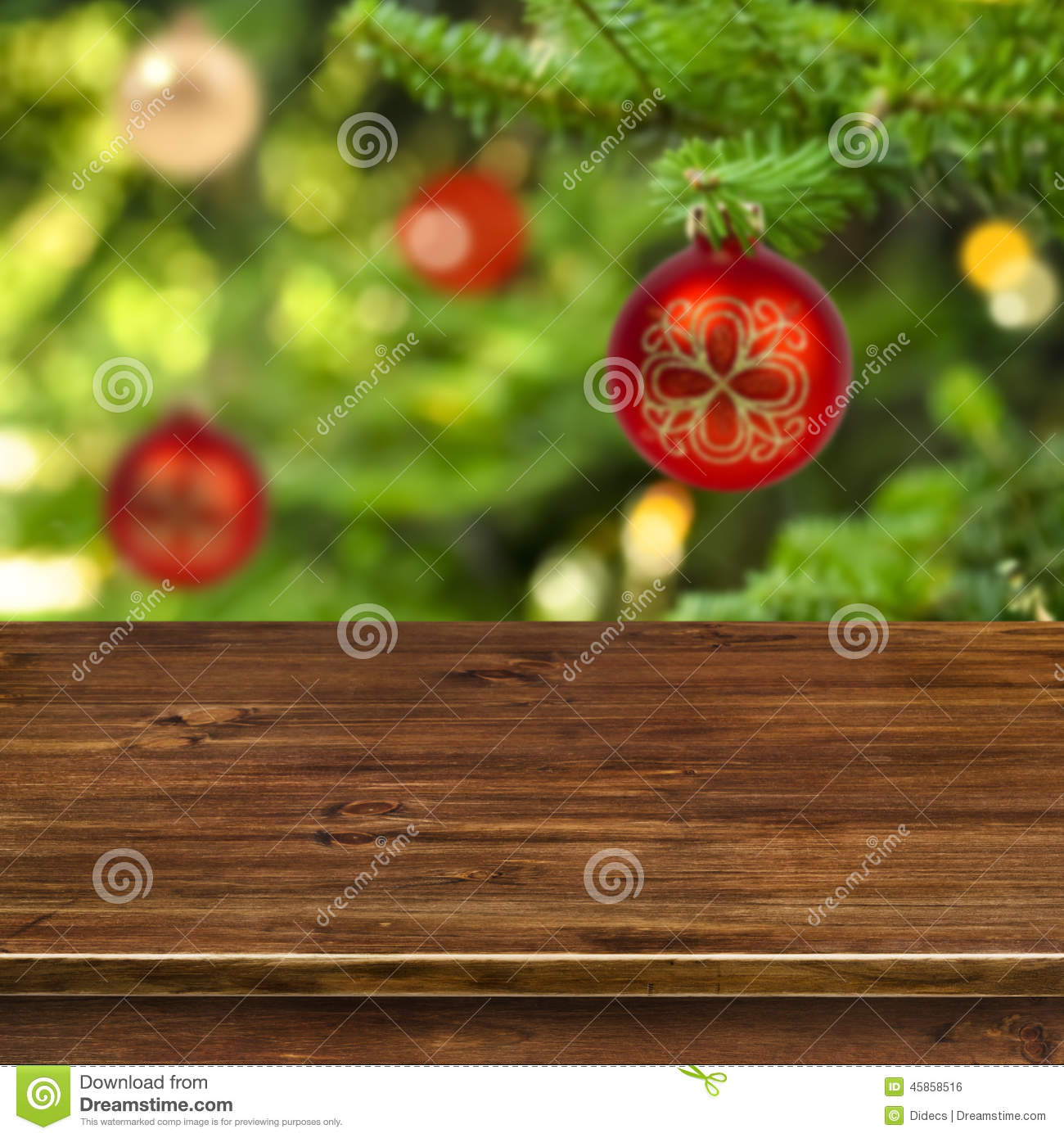 Wooden table on red Christmas ball background