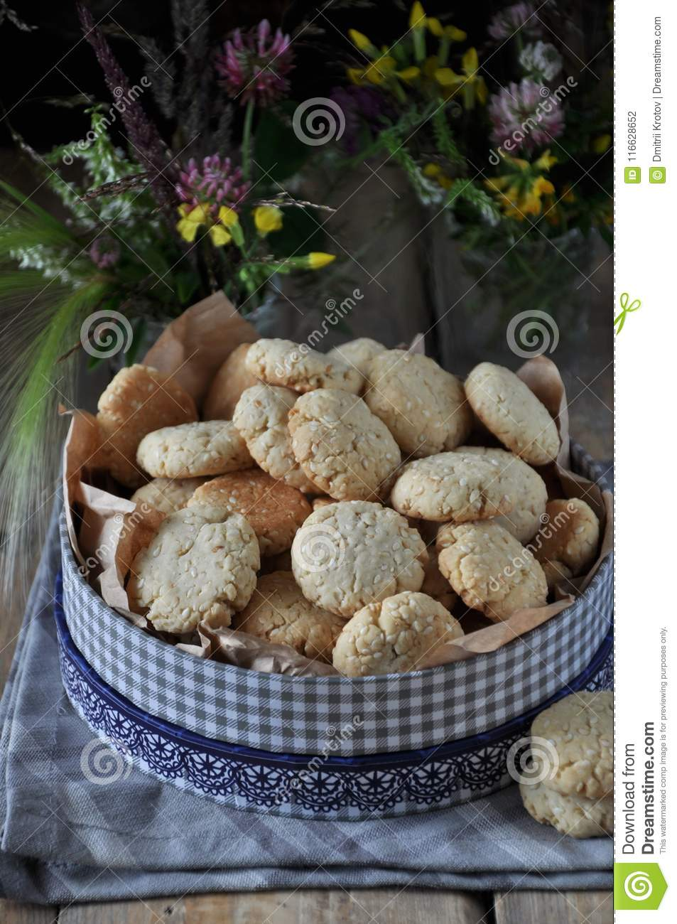 On A Wooden Table, Small Round Biscuits With Sesame Seeds Stock