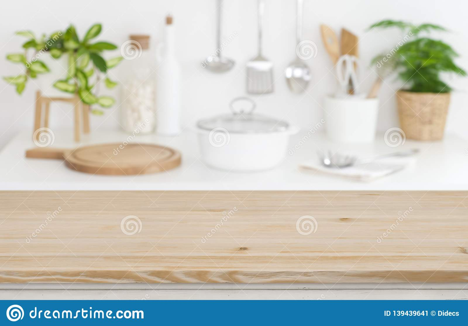 wooden table top on blurred kitchen counter background