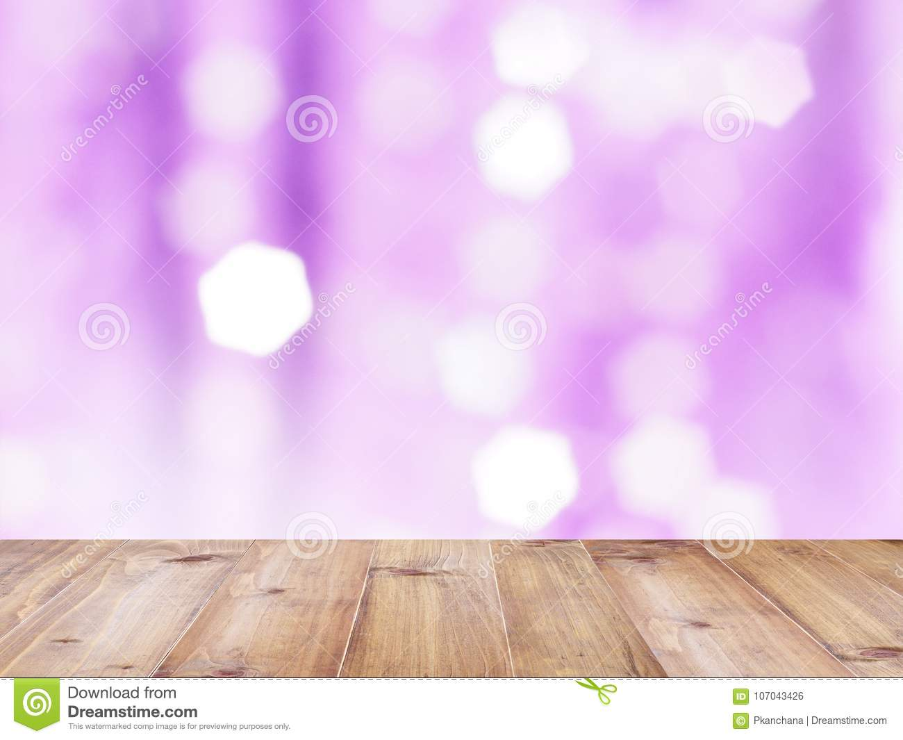 Wooden table top over violet abstract blured background