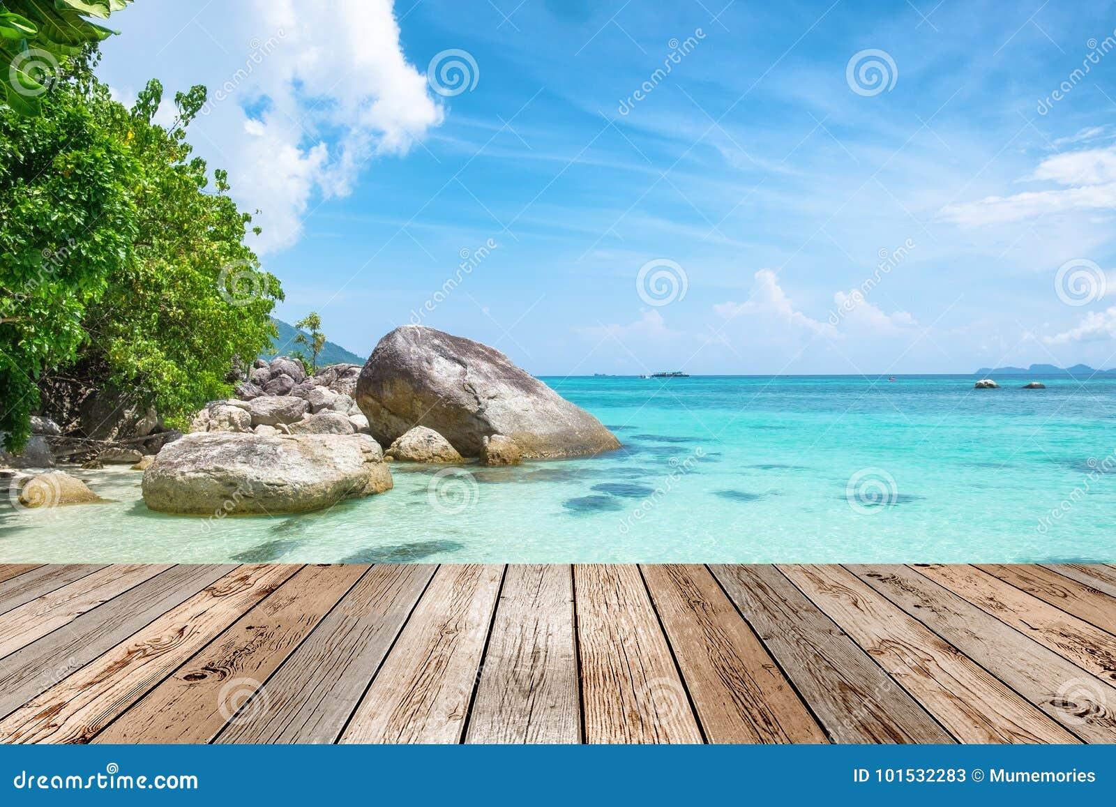 wooden table top on scene andaman crystal sea beautiful