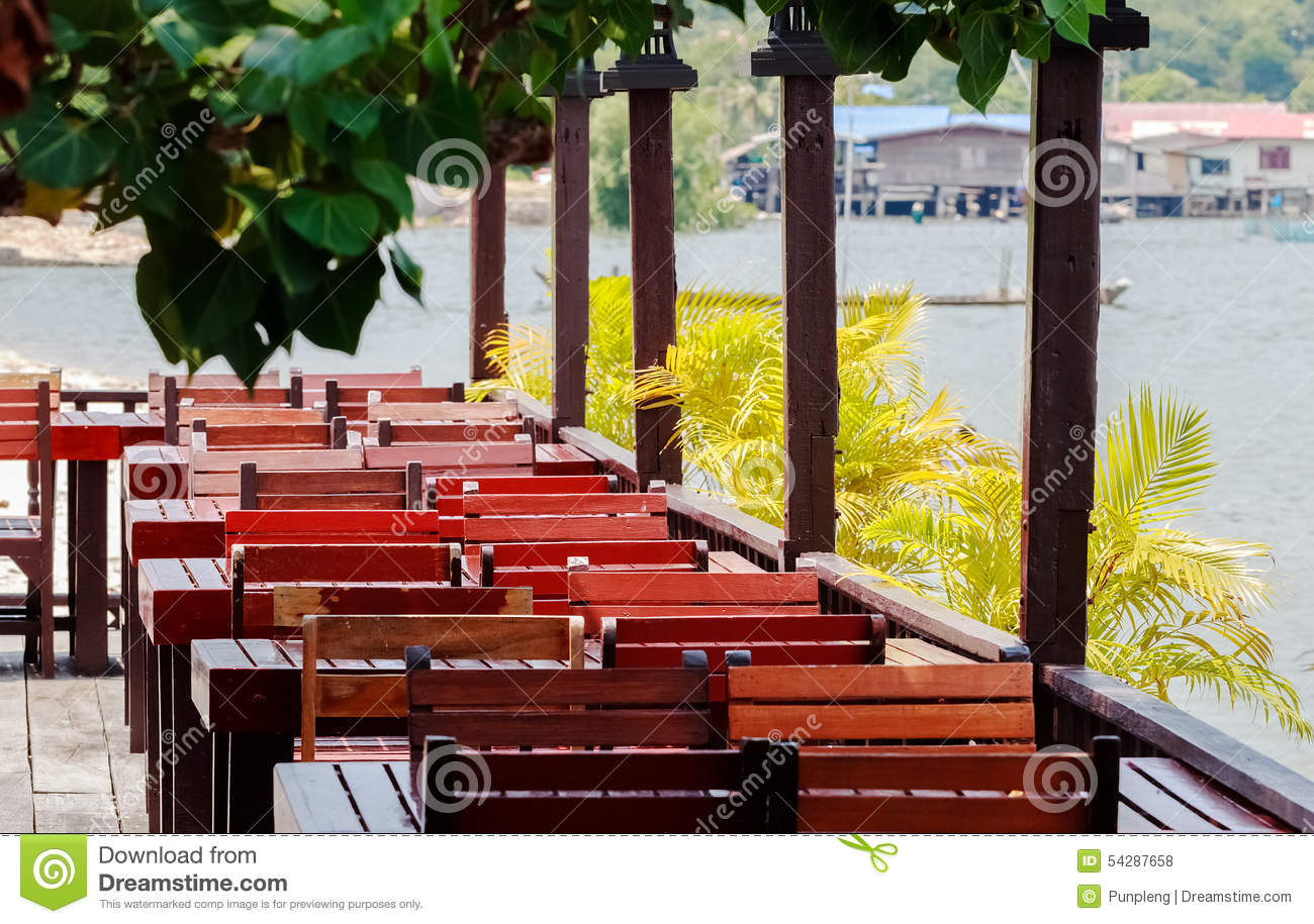 Wooden tables and chairs royalty free stock photography for Open terrace restaurants