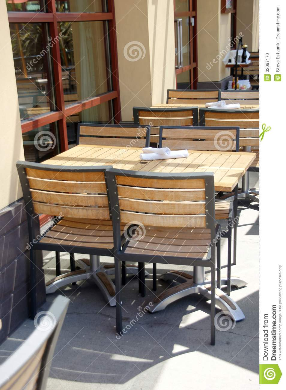 Wooden Tables And Chairs In Outdoor Restaurant