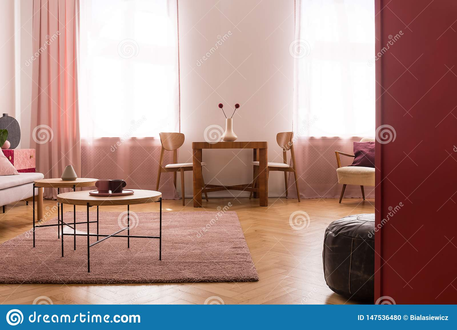 Wooden Tables On Purple Carpet In Living Room Interior With ...