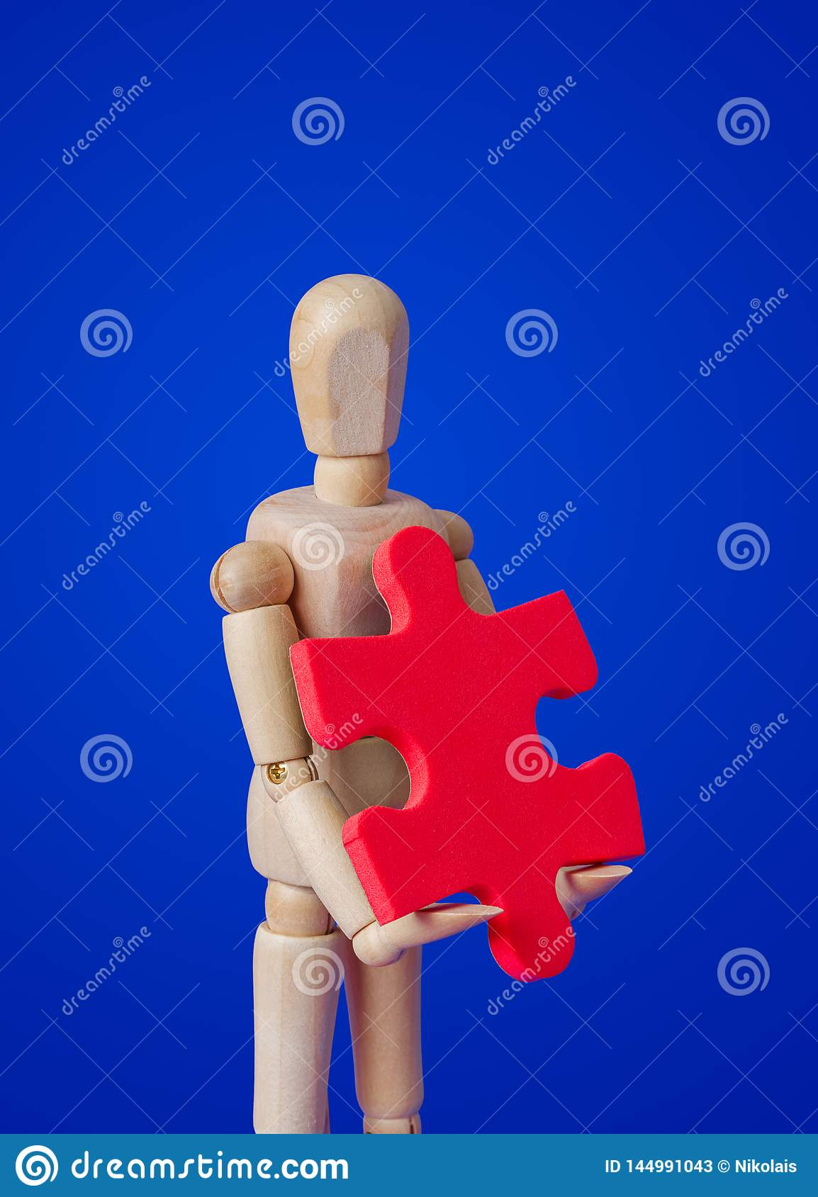 Wooden toy figure with puzzle on blue