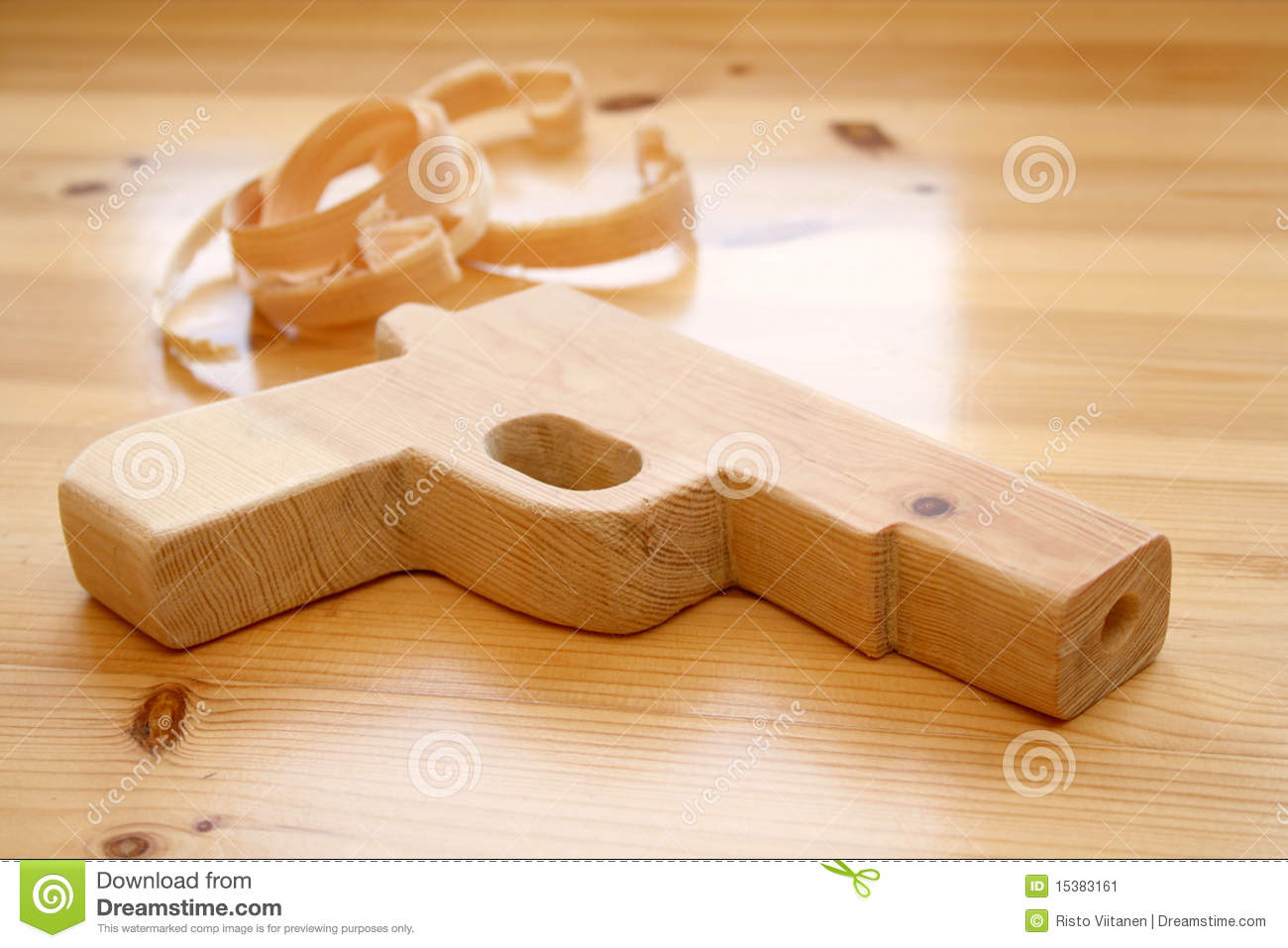 wooden toy gun with wood shavings stock image - image of