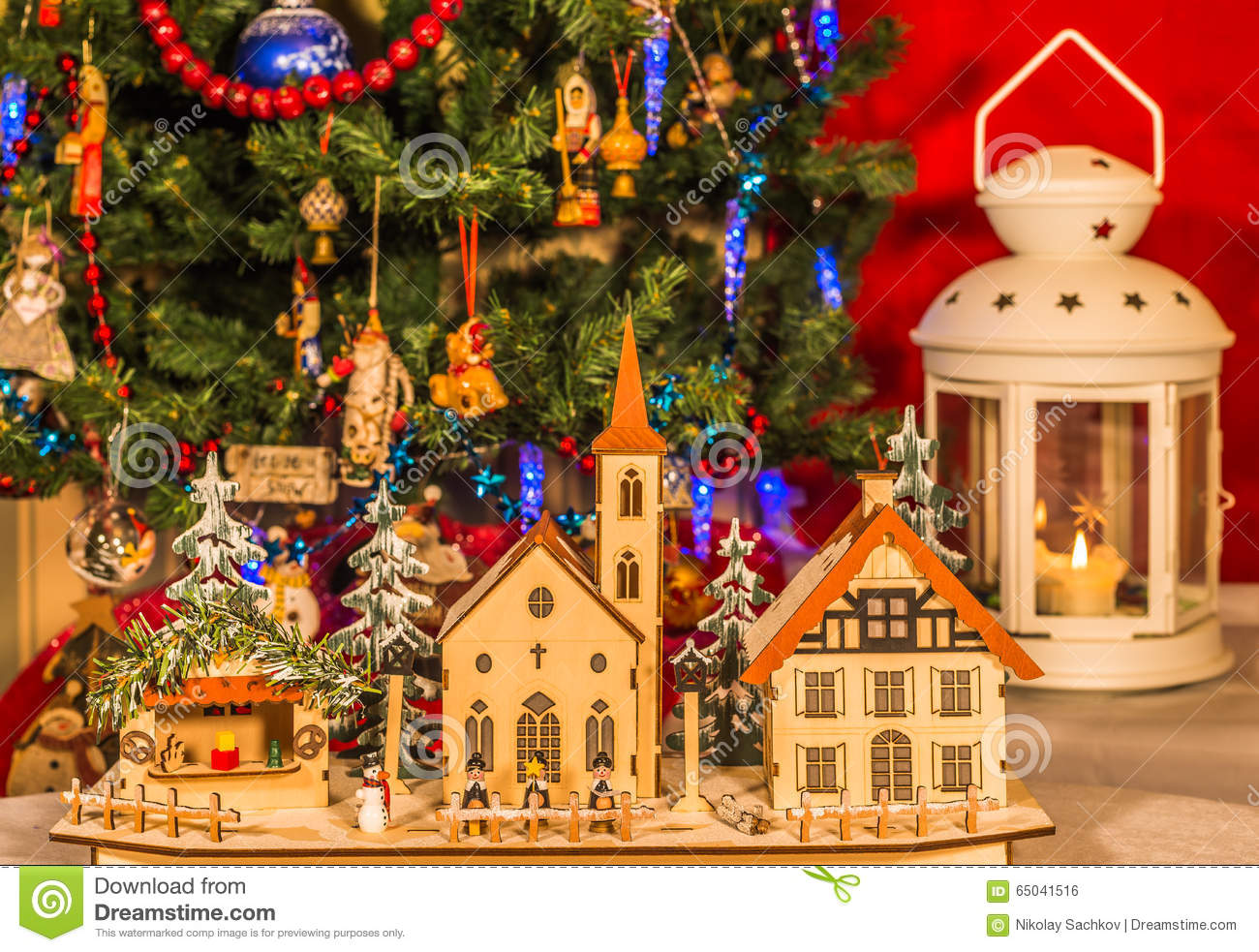 Wooden toy houses on a background of the christmas tree stock