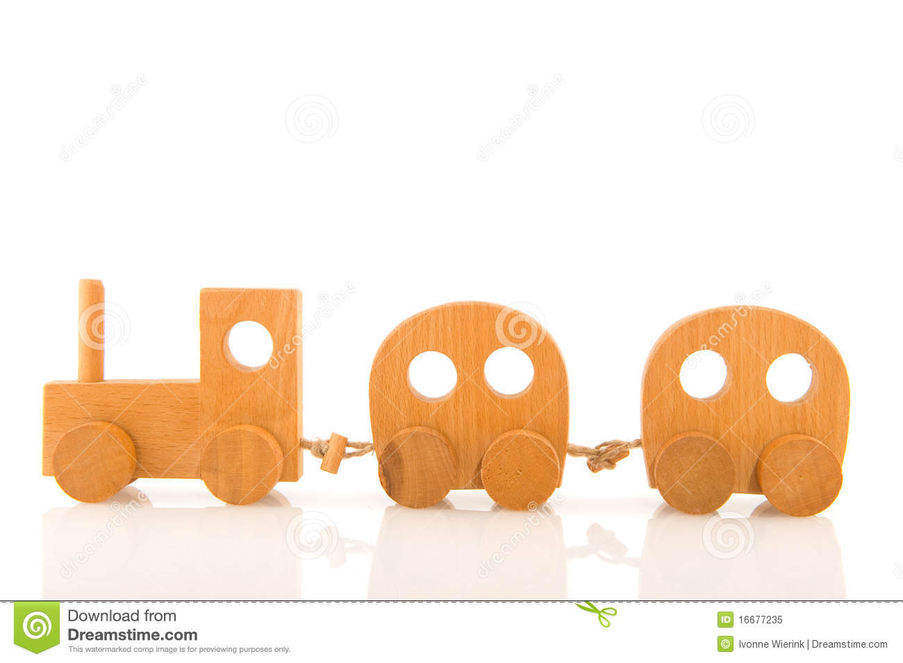 Wooden toy locomotive with wagons isolated over white.