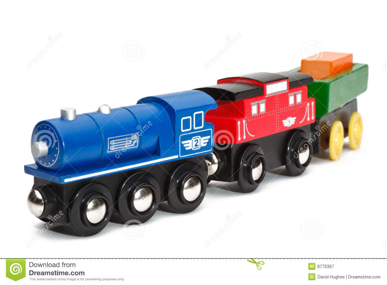 Wooden toy train on isolated white background.