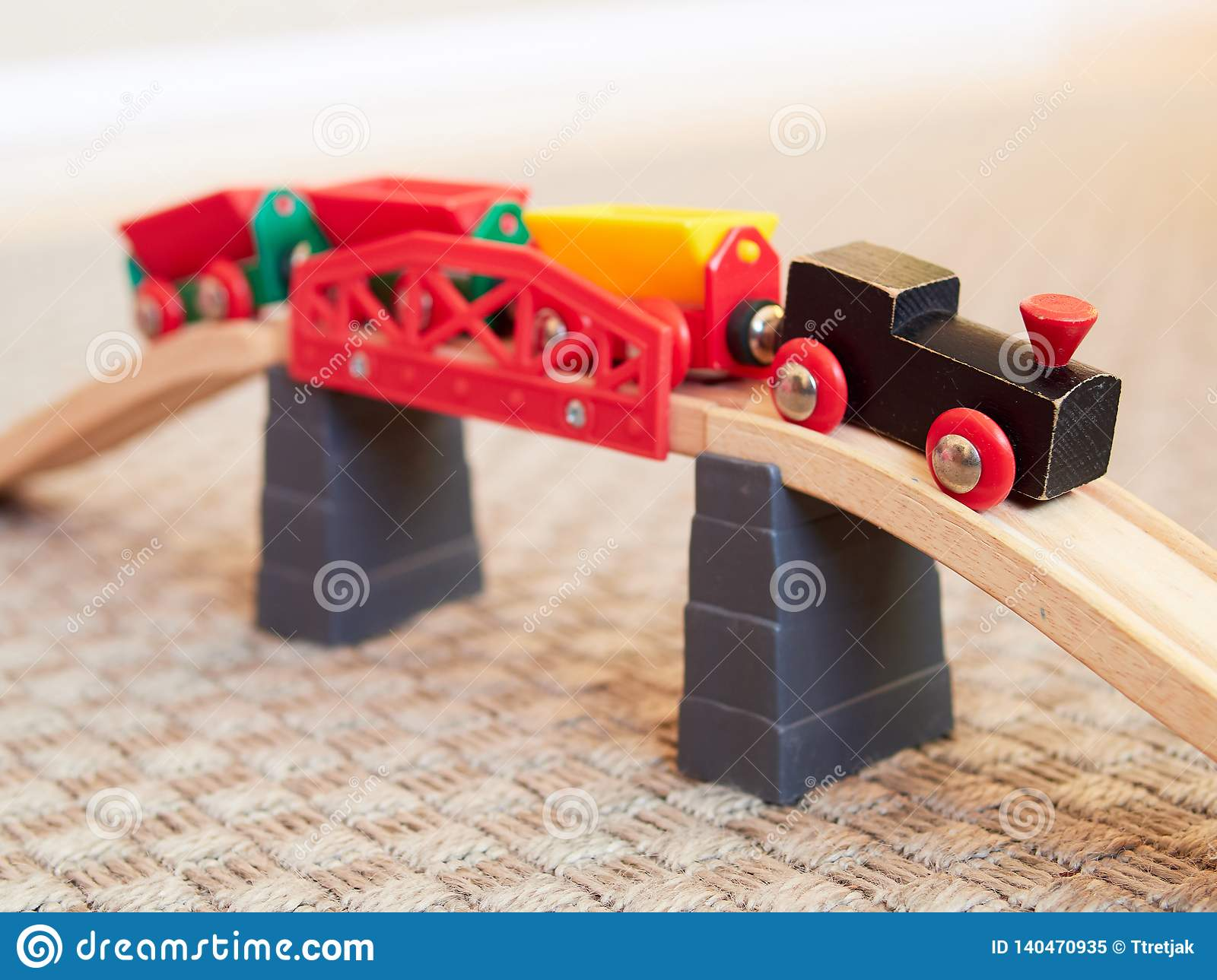 Wooden Toy Train Running On Miniature Track Stock Image