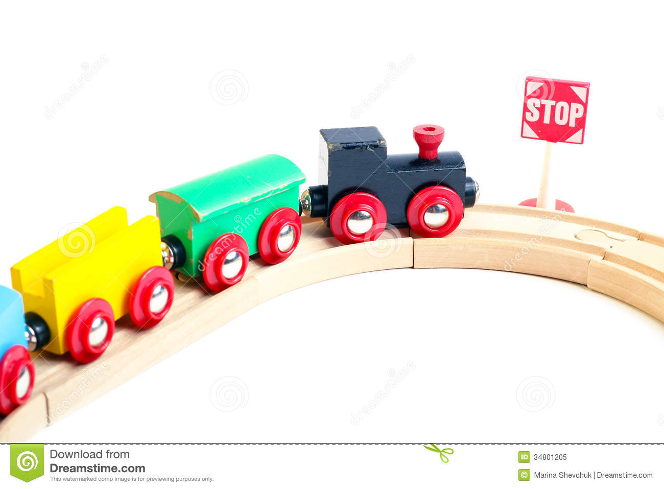 Wooden toy train on white background, selective focus.