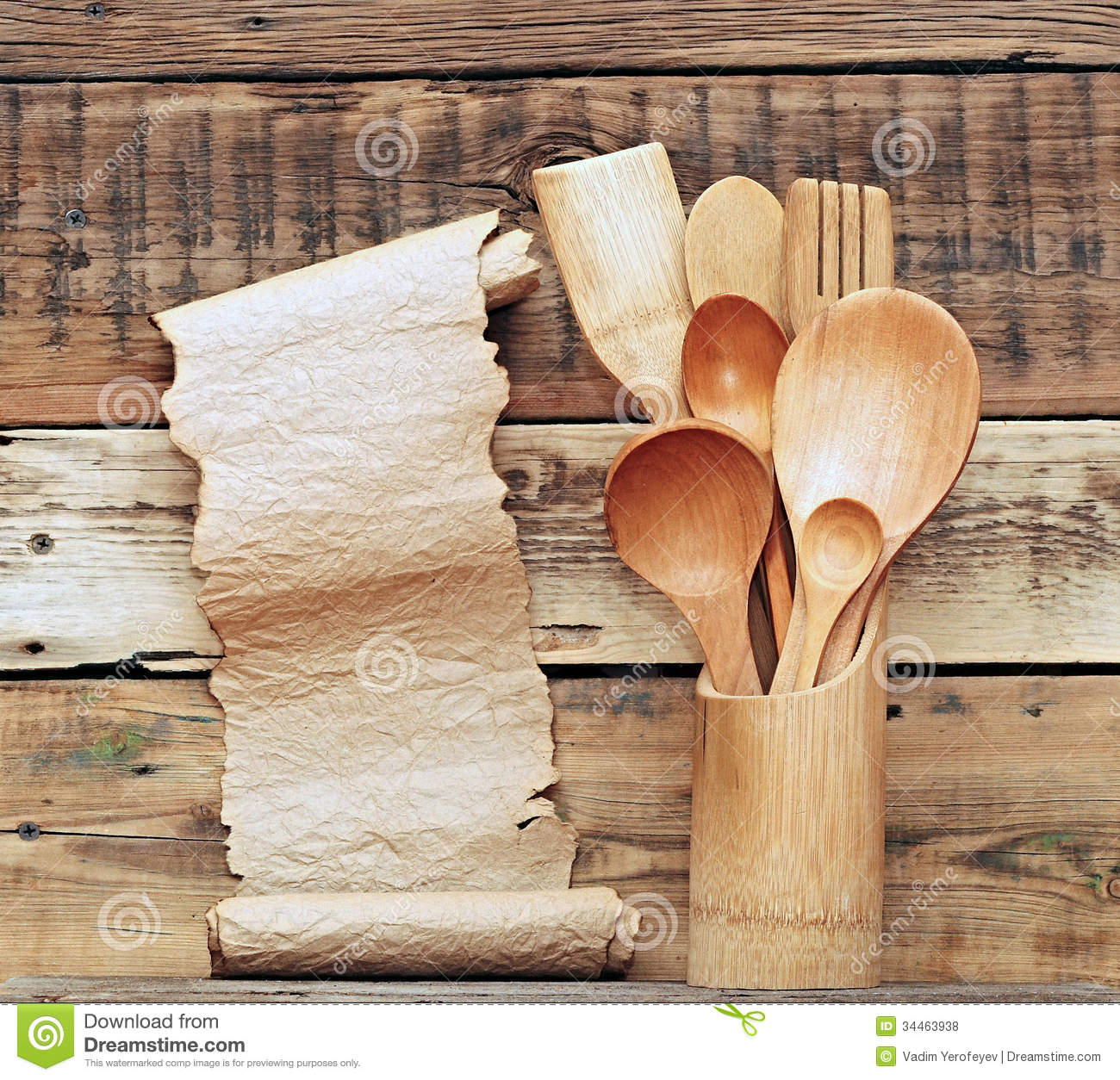 wooden utensils in retro bucket with blank paper scroll over wooden ...
