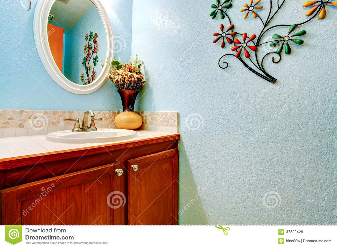 royaltyfree stock photo download wooden vanity cabinet in light blue bathroom