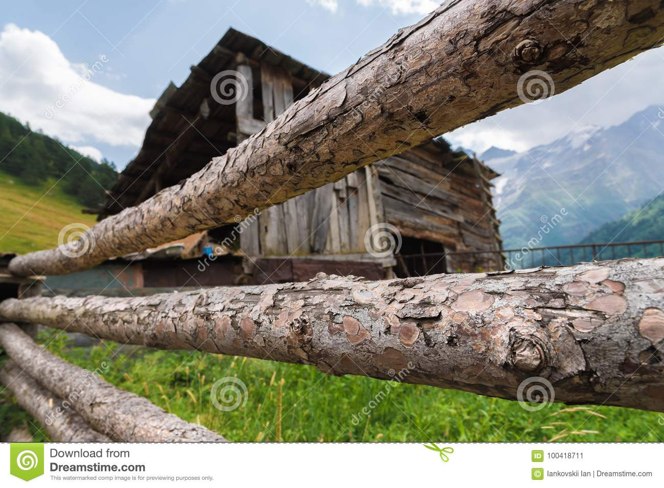 Wooden Vintage Fence On The Background Of An Old Wooden Barn In A