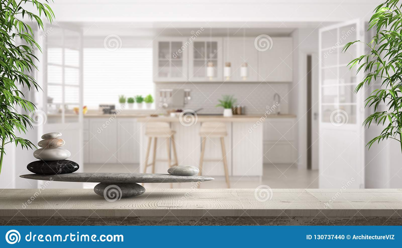 Wooden vintage table or shelf with stone balance, over blurred scandinavian classic white kitchen, feng shui, zen concept architec