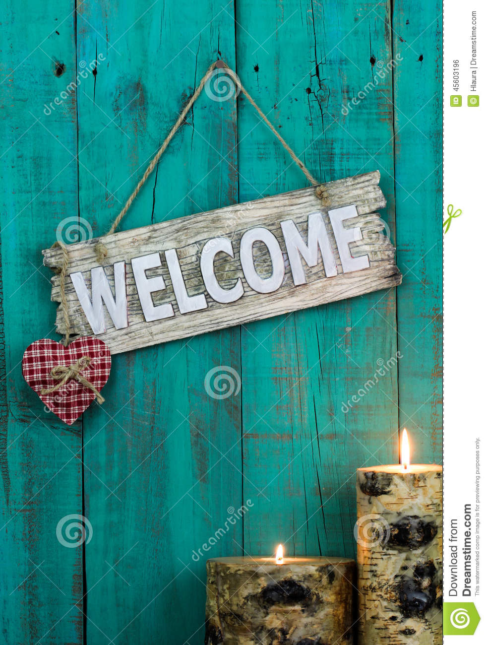 Wooden Welcome Sign With Red Heart And Burning Candles
