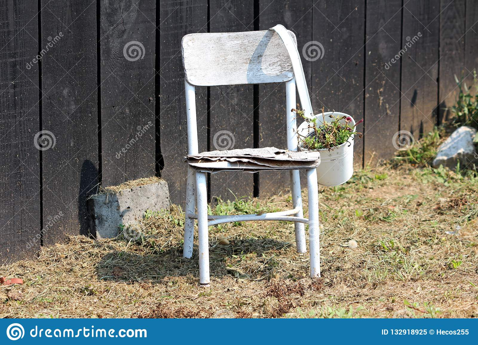 Wooden White Old Dilapidated Chair With Metal Flower Pot Used As Backyard Decoration In Front Of Black Wooden Barn Wall Stock Image Image Of Decoration Wooden 132918925