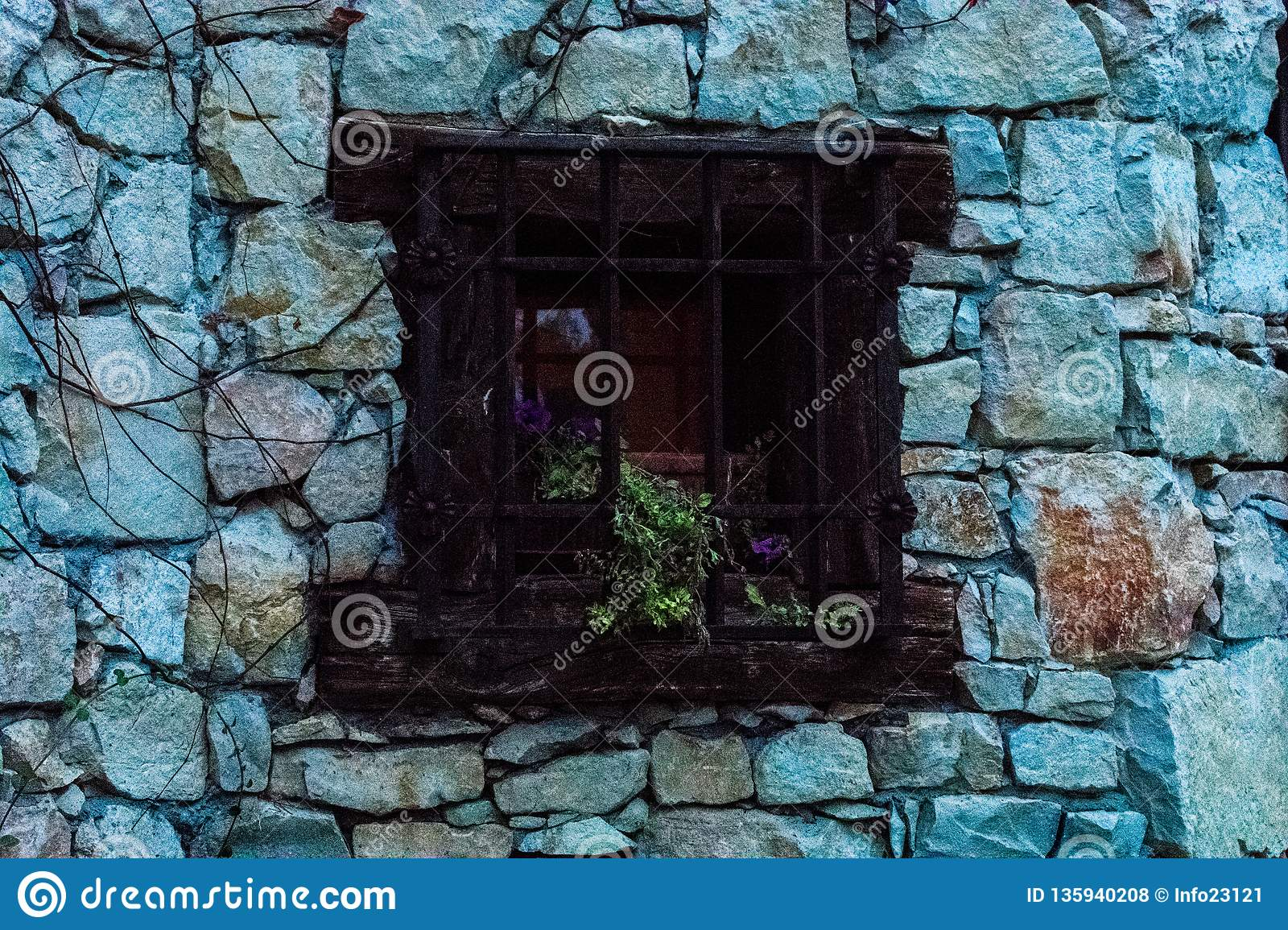 Wooden window in traditional stone house