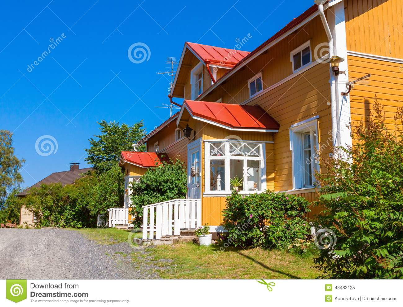 Wooden yellow house with red roof in scandinavian style for Yellow and red house