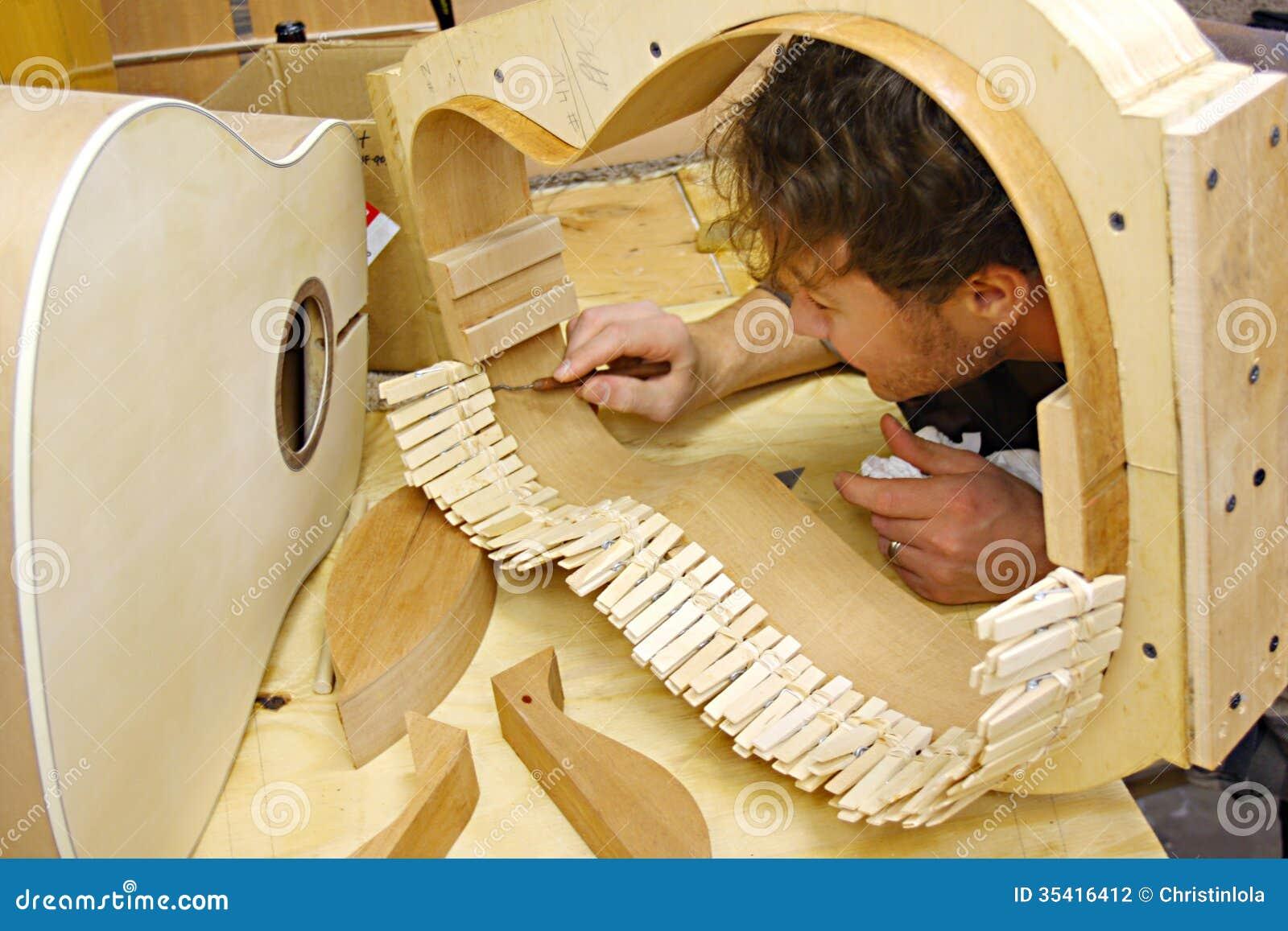 woodworker building guitar in workshop stock photo image 35416412. Black Bedroom Furniture Sets. Home Design Ideas