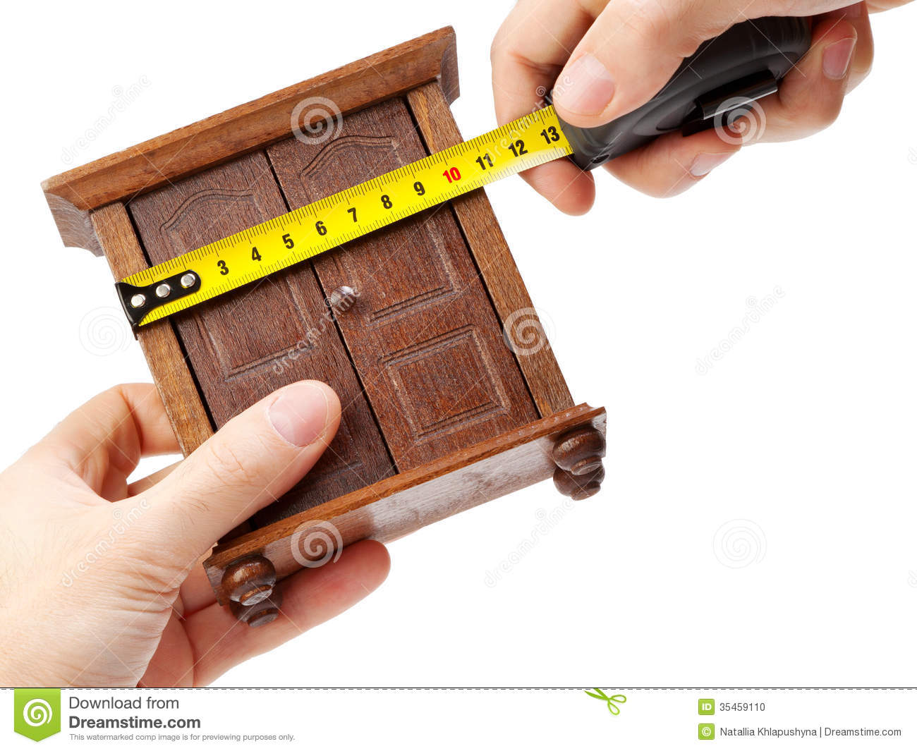 Woodworker Measuring Wardrobe With A Tape Measure