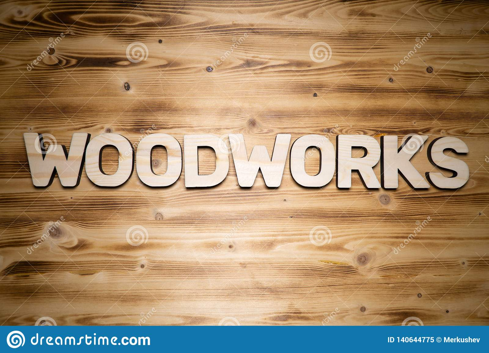 WOODWORKS word made of wooden block letters on wooden board