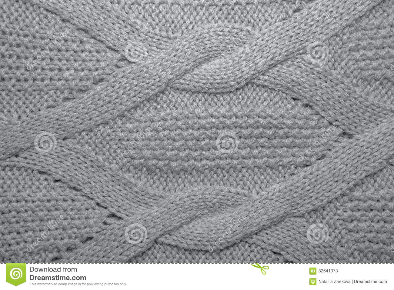 7bab1c7082d5a Knitted jersey background with a relief pattern. Pink wool sweater texture  close up