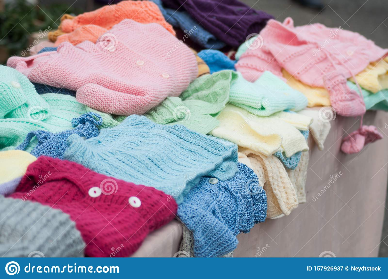 Woolen Baby Clothes Piles At Flea Market In The Street ...