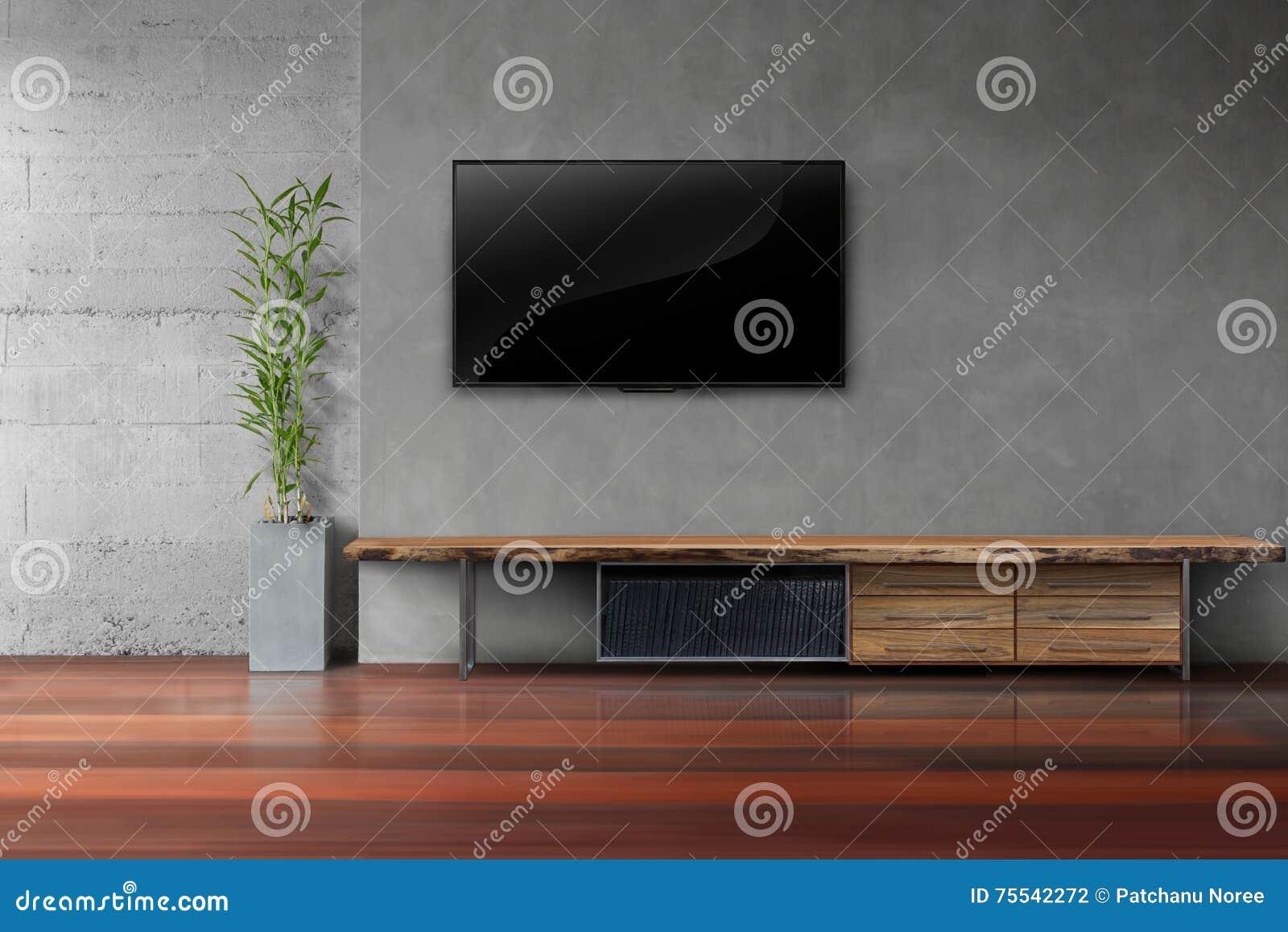 Houten Planken Muur Woonkamer.Woonkamer Geleide Tv Op Concrete Muur Met Houten Lijst Stock