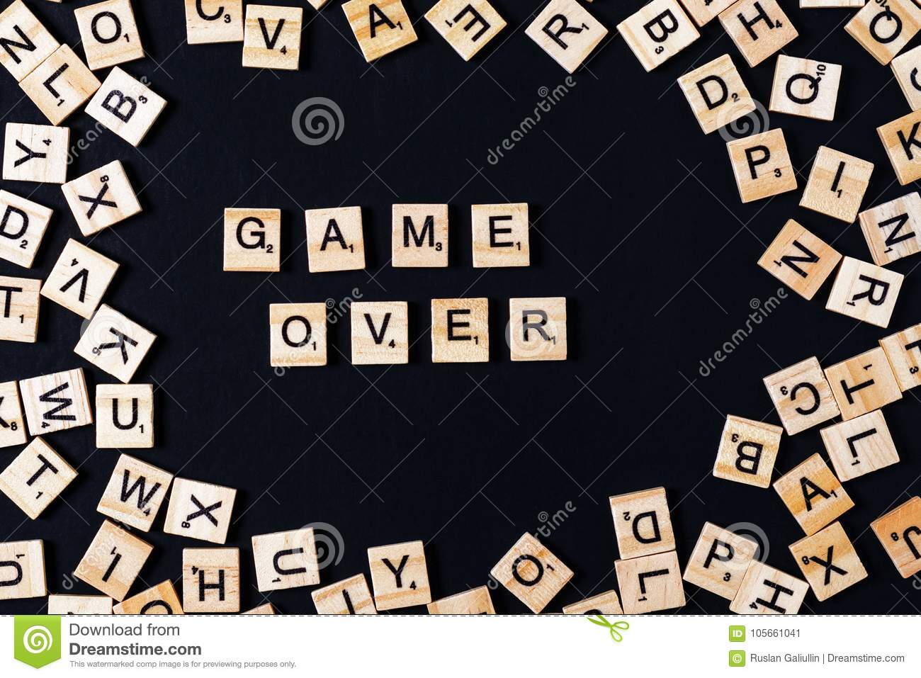 word board game with wooden letters on black board and letter in the