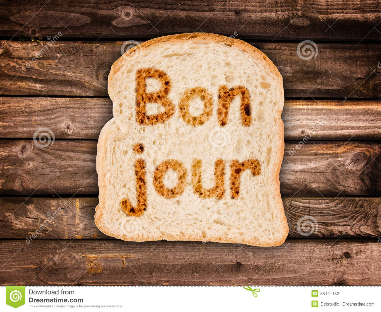 Word Bonjour Written On A Toasted Slice Of Bread Stock Photo Image