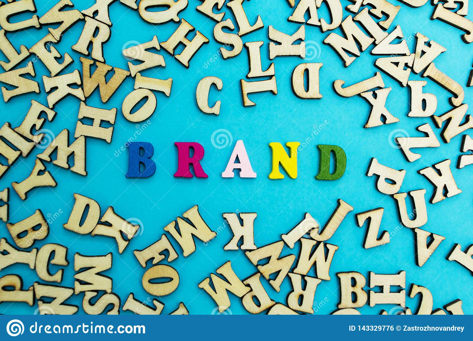 The word `brand` is lined with multicolored letters on a blue background