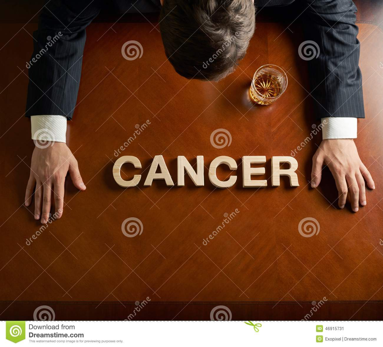 Word Cancer and devastated man composition