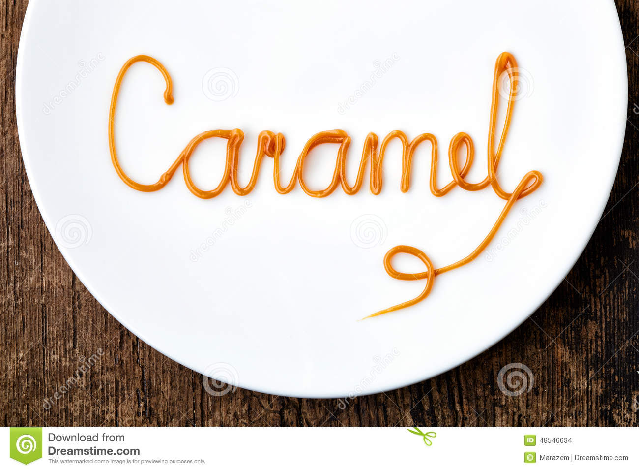 Word: Word Caramel On White Plate Stock Photo