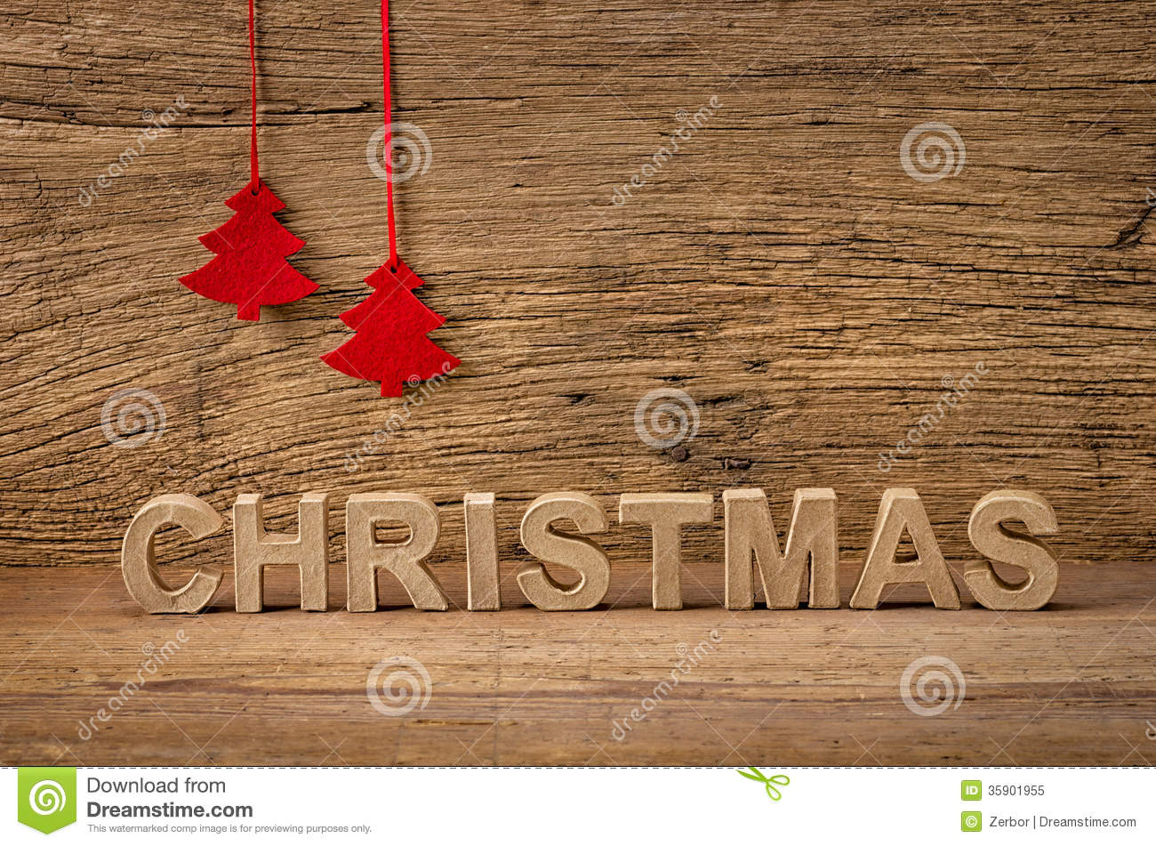 The Word Christmas In Front Of A Wooden Background Stock
