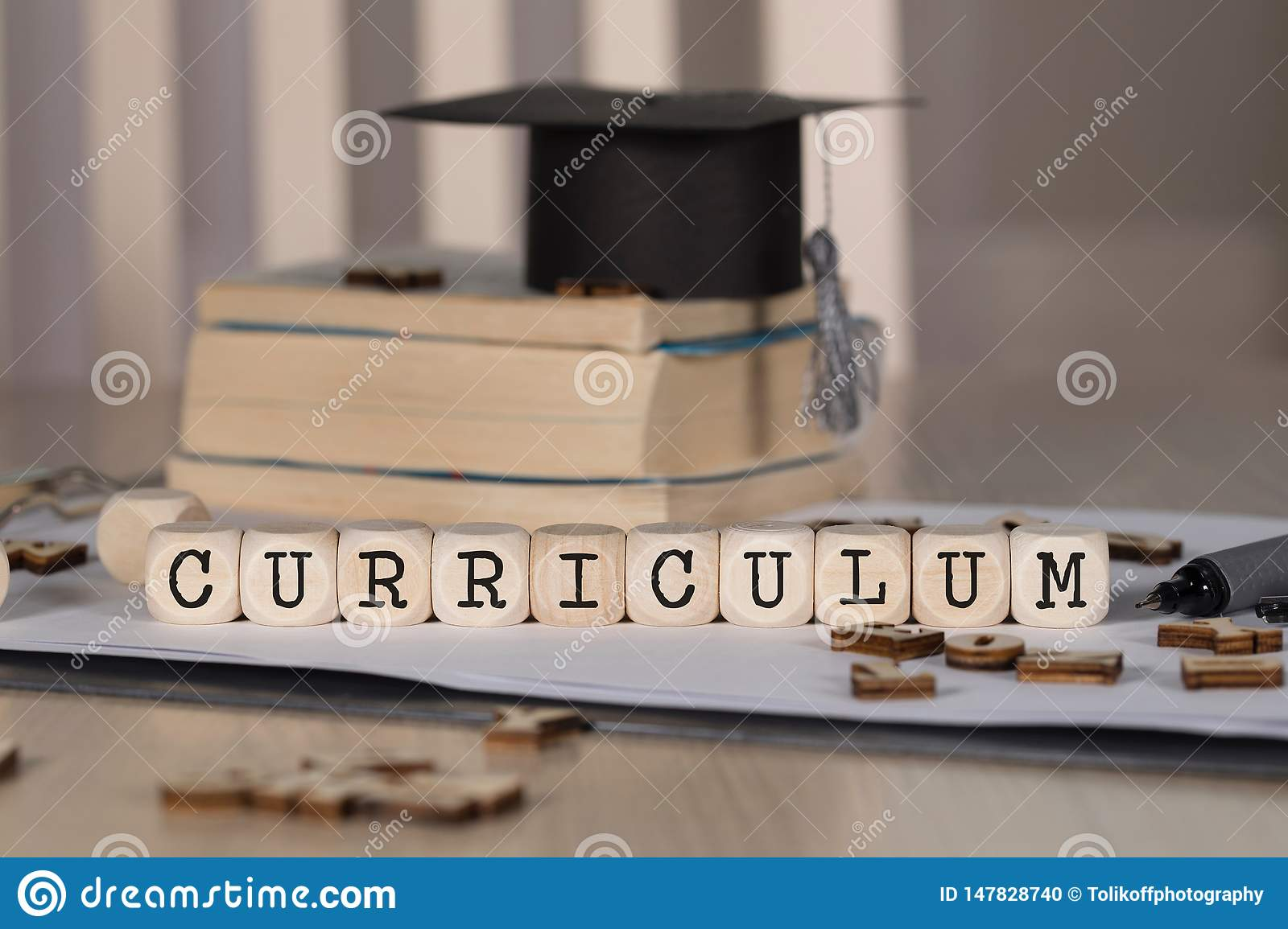 Word CURRICULUM composed of wooden dices