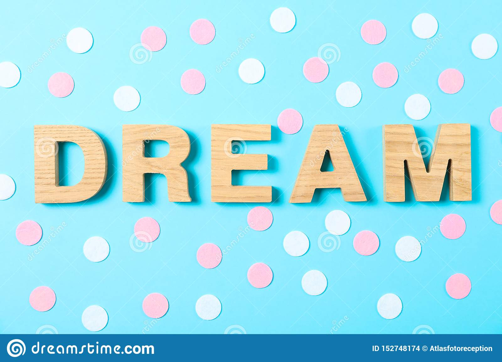 Word Dream Lined With Wooden Letters On Color Background Stock Photo