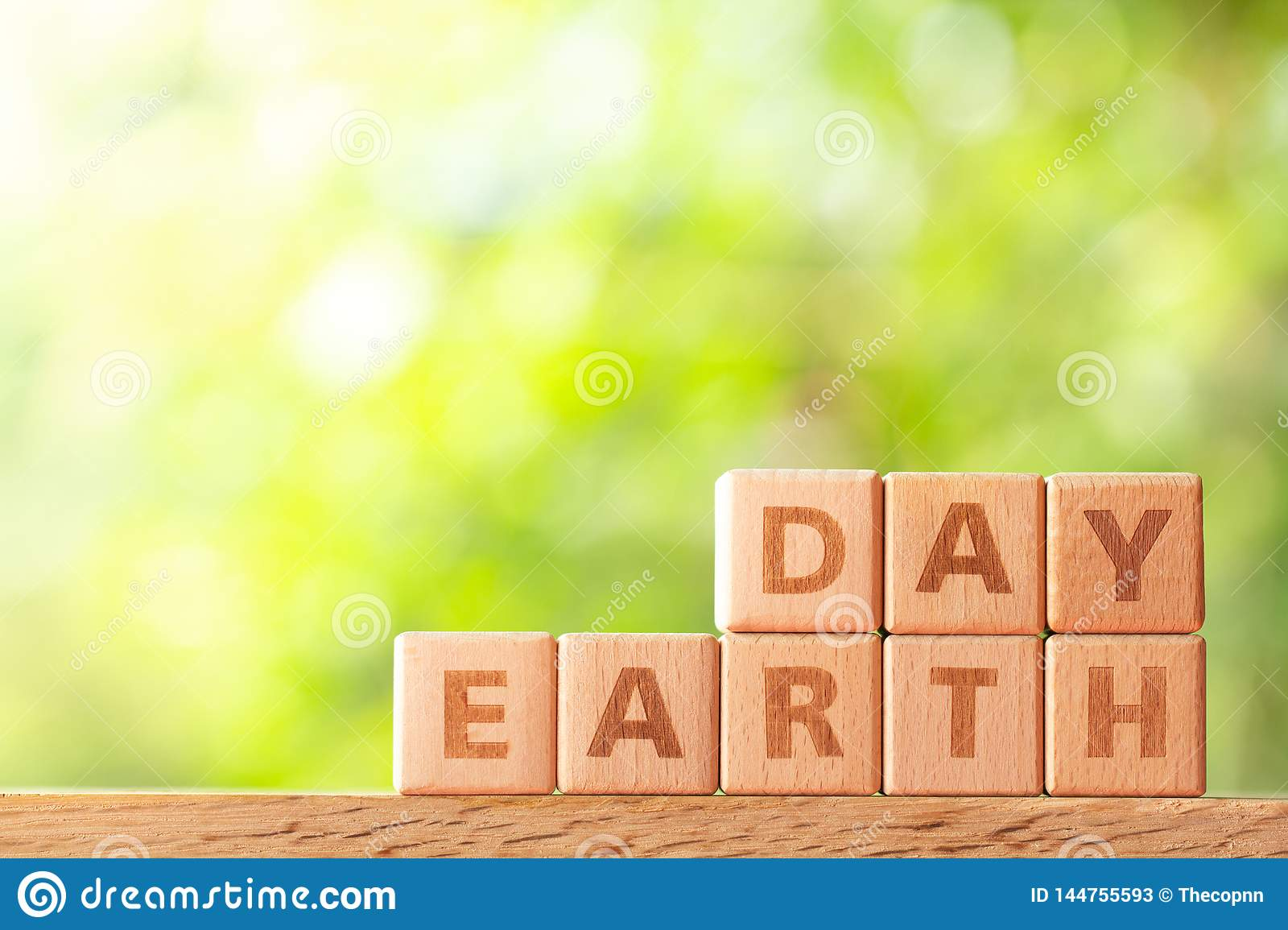Word earth day written on wooden block on wood table