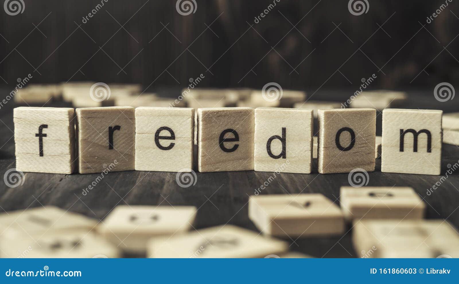 Word freedom written on wooden blocks