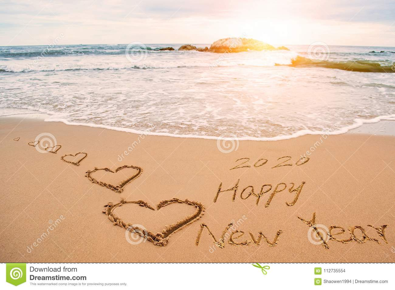 download write happy new year 2020 on beach stock photo image of write wave