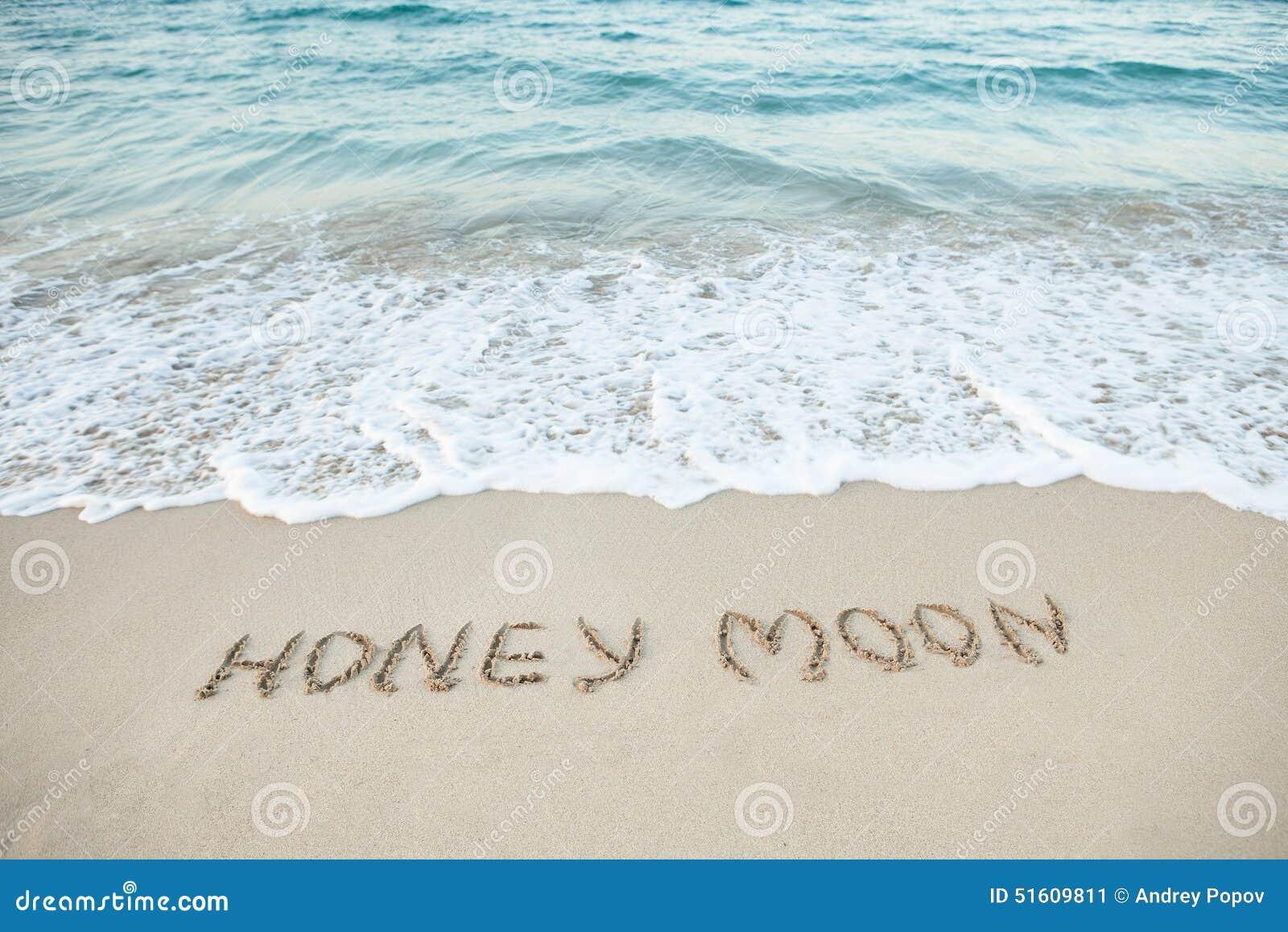 Word Honeymoon Written On Beach Stock Image